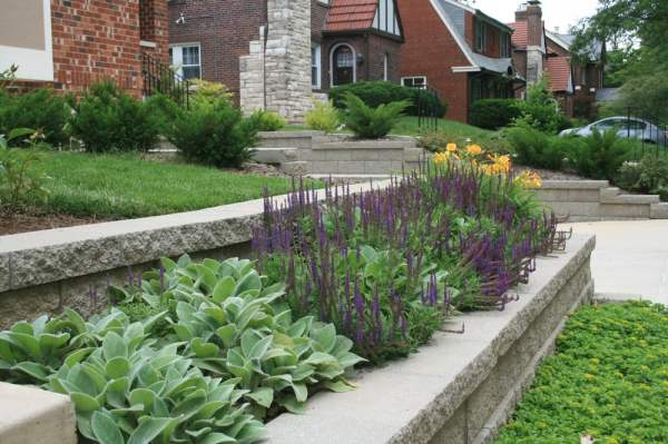 retaining wall and flower bed featuring