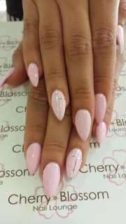 baby pink stiletto nails with cross
