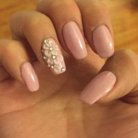 Pink gels with white 3D nail art with jewels on natural ...