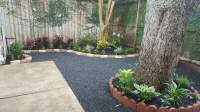 Backyard landscape with black star gravel patio. - Yelp