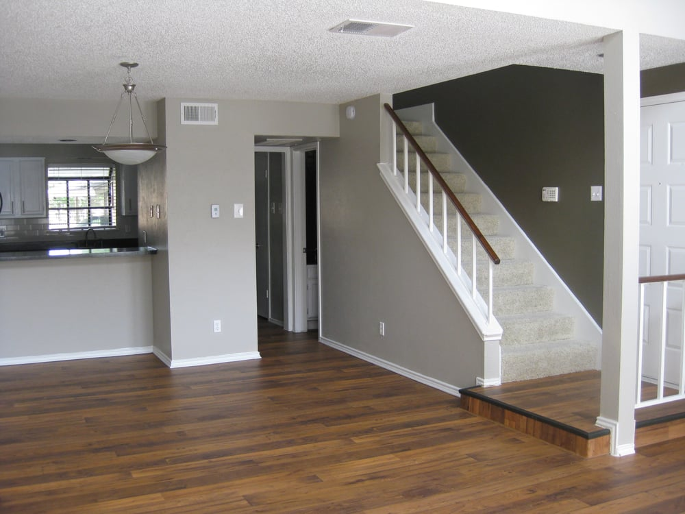 Wood flooring and two tone walls accent this dramatic