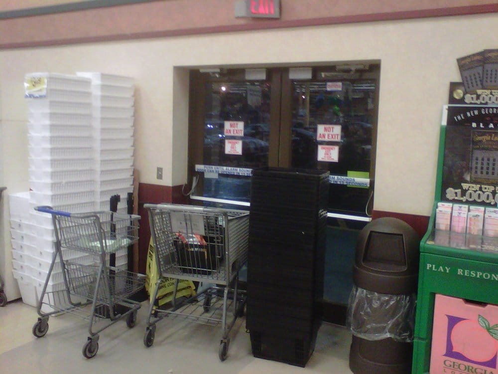 Blocked Emergency Exit near the Customer Serivice Counter