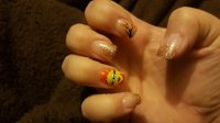 He painted a Thanksgiving minion on my nail!