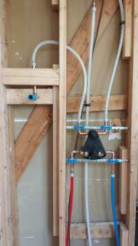 New shower valve rough-in with PEX piping on a 3 function ...