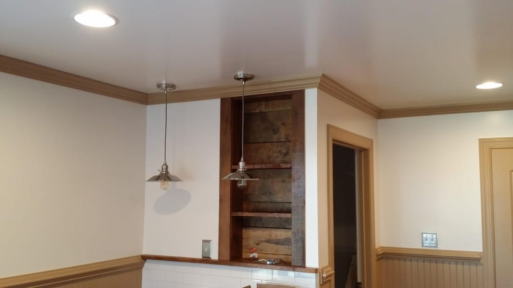 Old barn wood was used to for a builtin shelf Crown