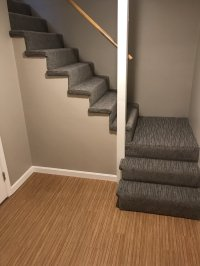 Beautiful stairs down to a finished basement carpet ...