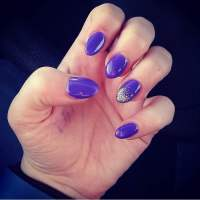 Purple almond shaped artificial gel nails with gel polish ...