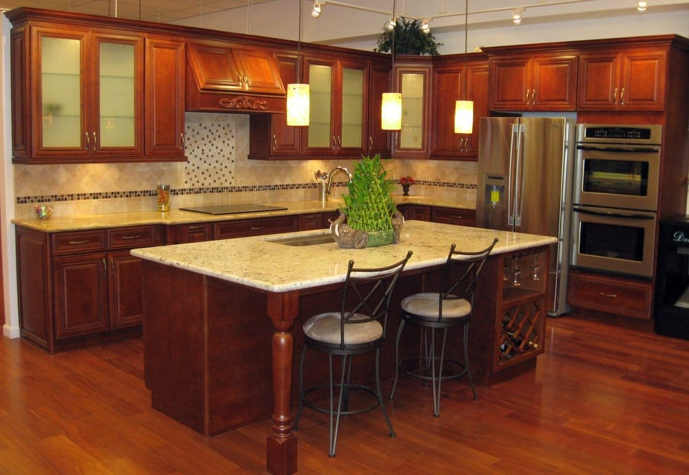 Sycamore Cherry Cabinets with Giallo Regal Granite counters and an island done in Crystal White