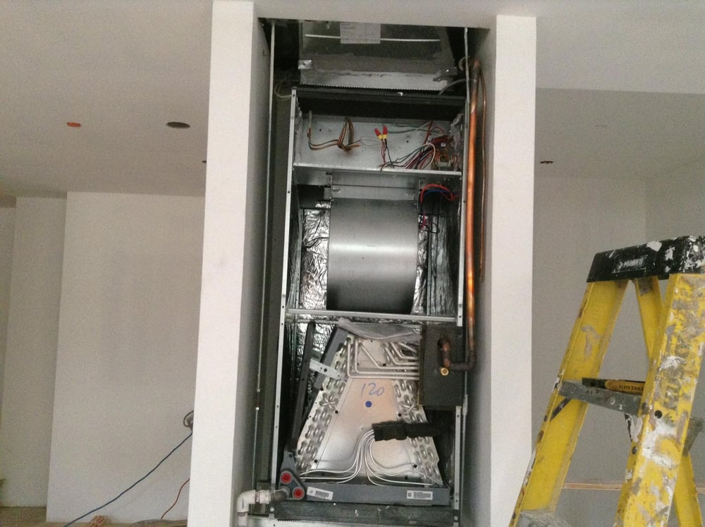 View of the inside of an air handler for a split HVAC unit This portion is installed in an