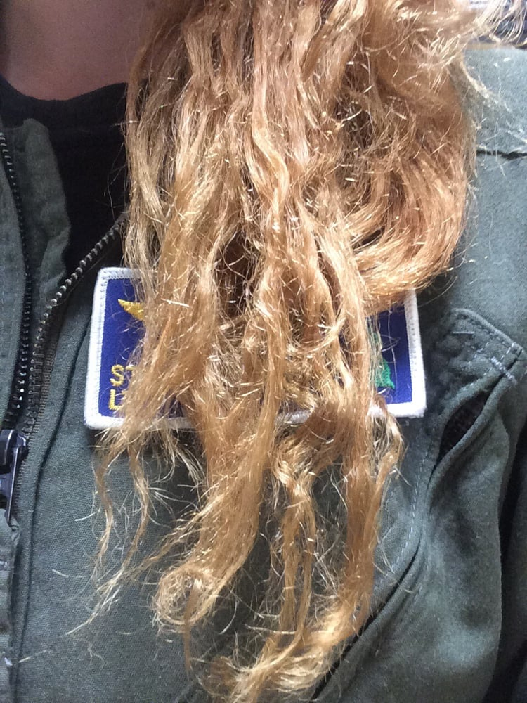 Chopped off now Dry rough strawlike hair When wet
