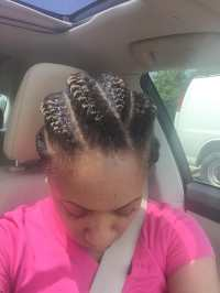My cornrows looked much better after they were redone by