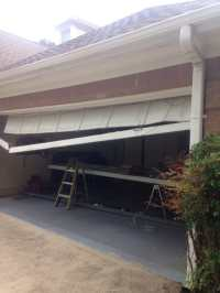 Broken garage door in Alpharetta Georgia. Garage door ...