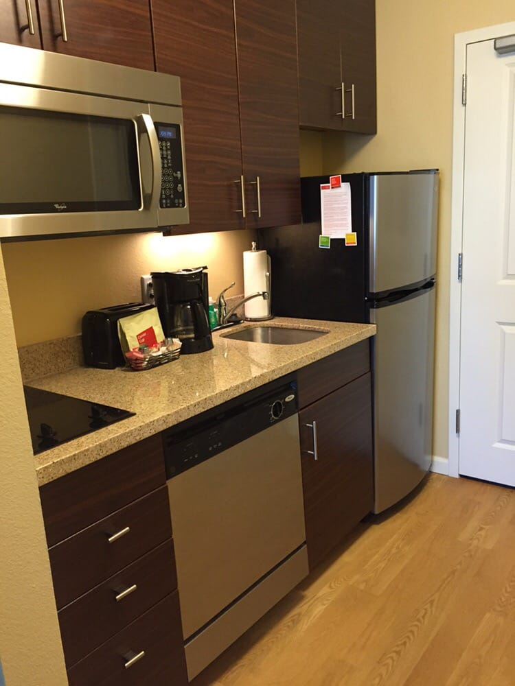 Kitchenette Equipped With Stovetop Microwave Toaster