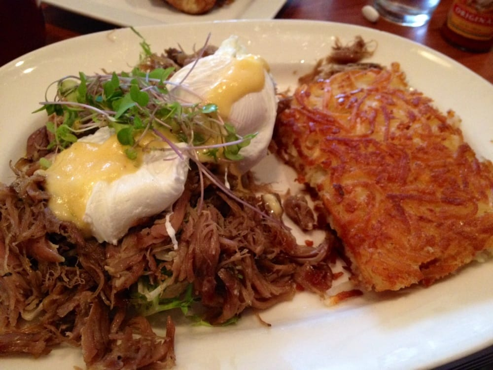 Blue's Egg - Milwaukee, WI, United States. Duck Confit over a house made English Muffin, Poached Eggs with Hollandaise and Hash browns.