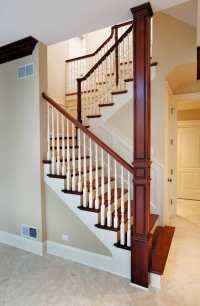 U-Shape Stair With Wood Baluster and Column Wrap that ...