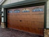 Steel wood grain garage door with wrought iron windows ...