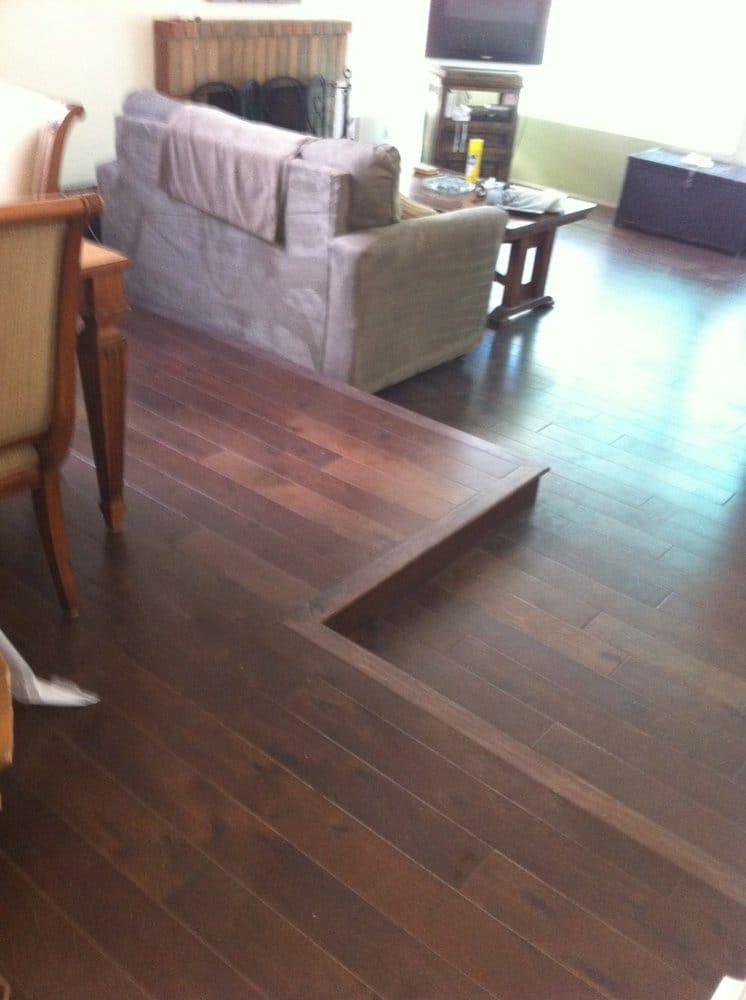 laminate flooring sunken living room modern french design new wood floor w transition yelp 25 photos for smart floors