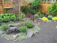 Small backyard makeover, including bubbler rock and ...