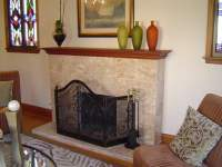 Fireplace Remodel. Marble tile over brick. | Yelp