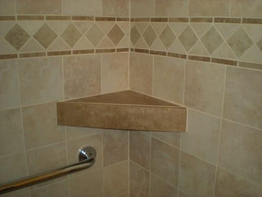 Custom shower tile shelf