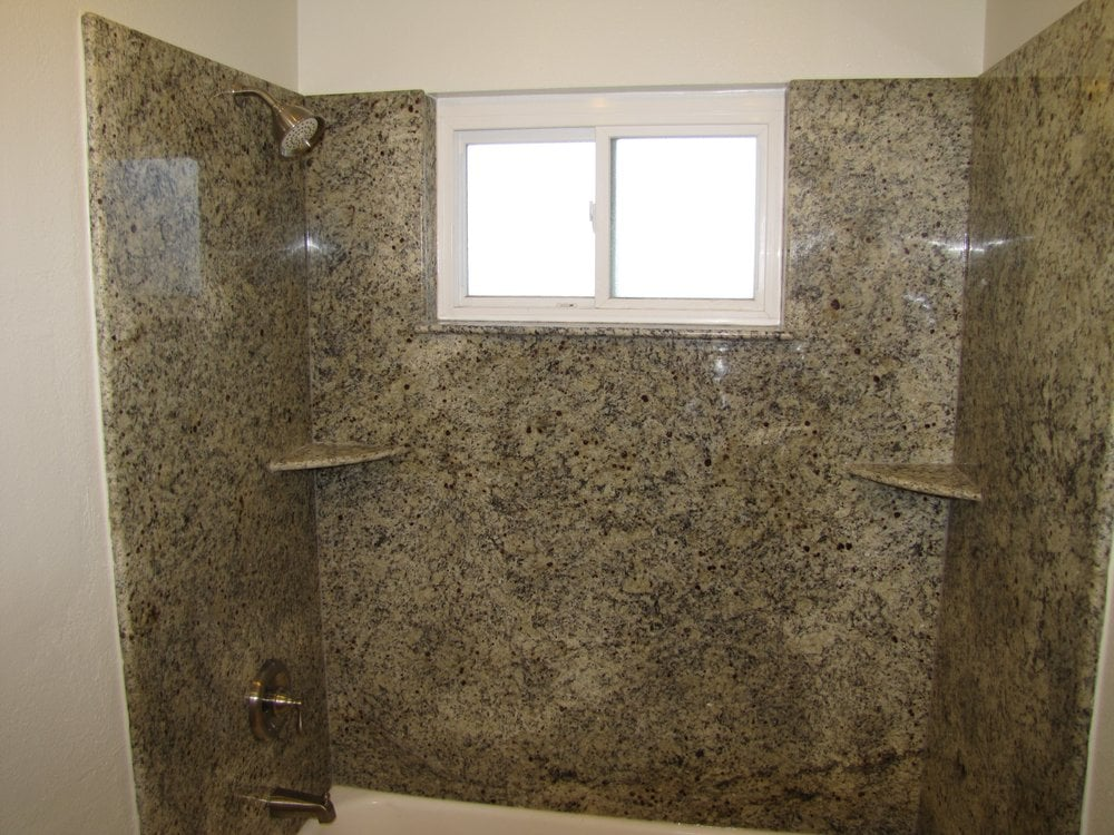 Granite slab shower walls and new Moen valve