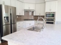 White Shaker Cabinets with Gray Lagoon Custom Quartz ...