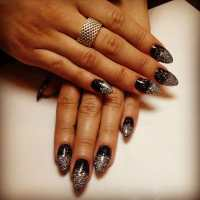 New Years themed nails. Black stilettos with glitter ombr ...