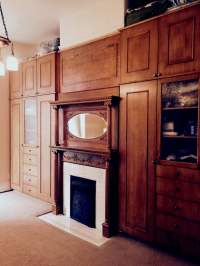 Matching Storage Cabinets next to a 1910 fireplace in San ...