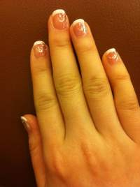 Got a nice French Manicure with a pretty design at ...