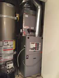 Furnace and A/c combo next to water heater in central ...