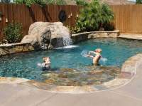Small play pool with custom diving waterfall and quartzite ...