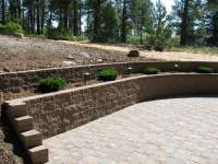 Terraced retaining wall concrete paver patio - Yelp