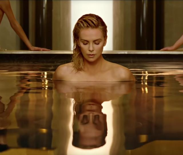 Charlize Theron Walking Naked Out Of A Pool Is What Female Empowerment Looks Like In Diors World
