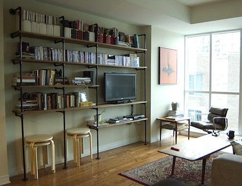 diy shelves in living room swivel rocker recliners furniture 5 ways to build yours bob vila pipe fittings