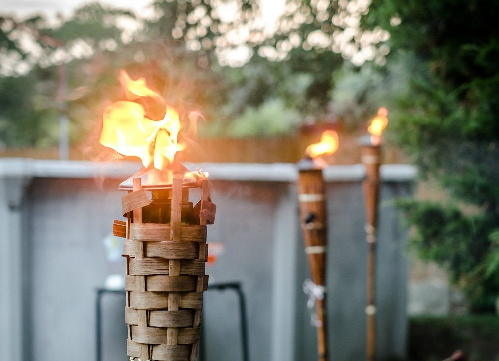 garden oasis patio chairs hair on hide dining tiki torch - diy outdoor lighting 8 cool lights bob vila