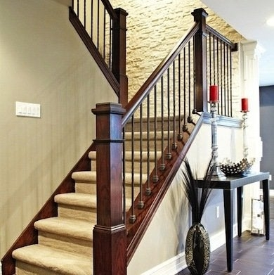 Staircase Railing 14 Ideas To Elevate Your Home Design Bob Vila | Metal And Wood Interior Railings | Contemporary | Art Craft | Black Glass Interior | Wood Cap | Metal Exterior Brown