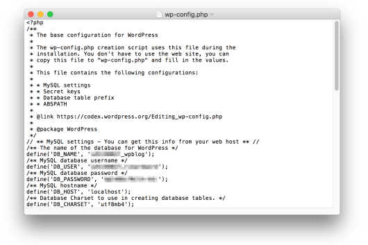 The wp-config.php file open in TextEdit.