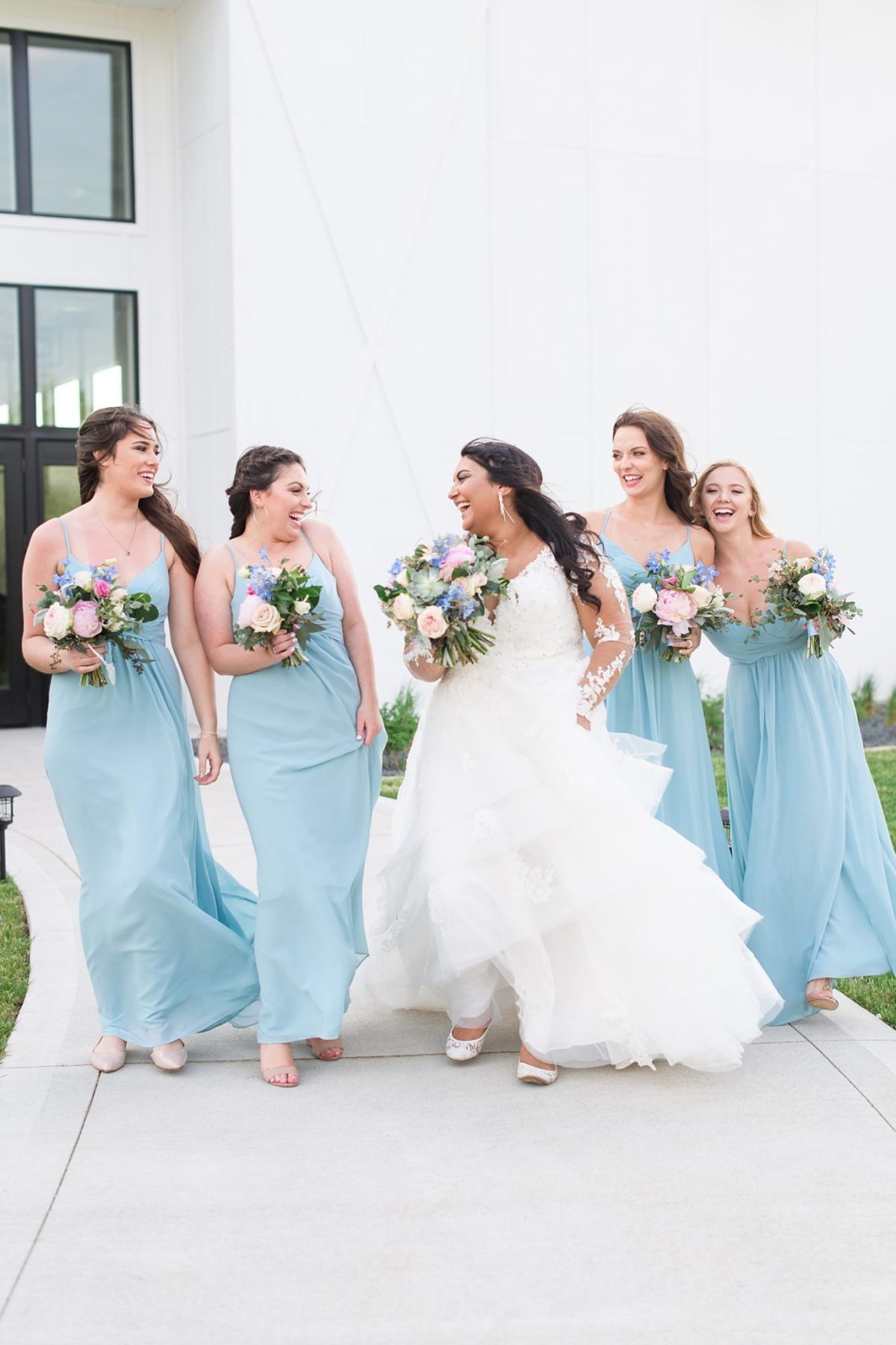 bridal party in front of emerald hills events center