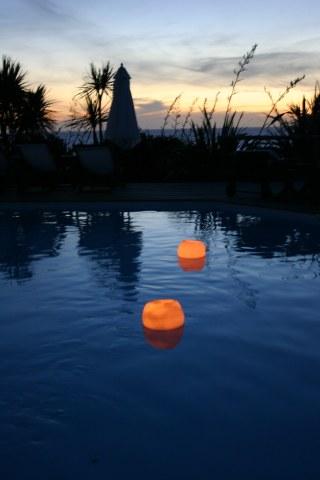 Posada del Faro pool candles at dusk
