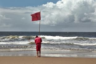 Jose Ignacio surf flag guy