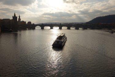 Prague boat at sunset