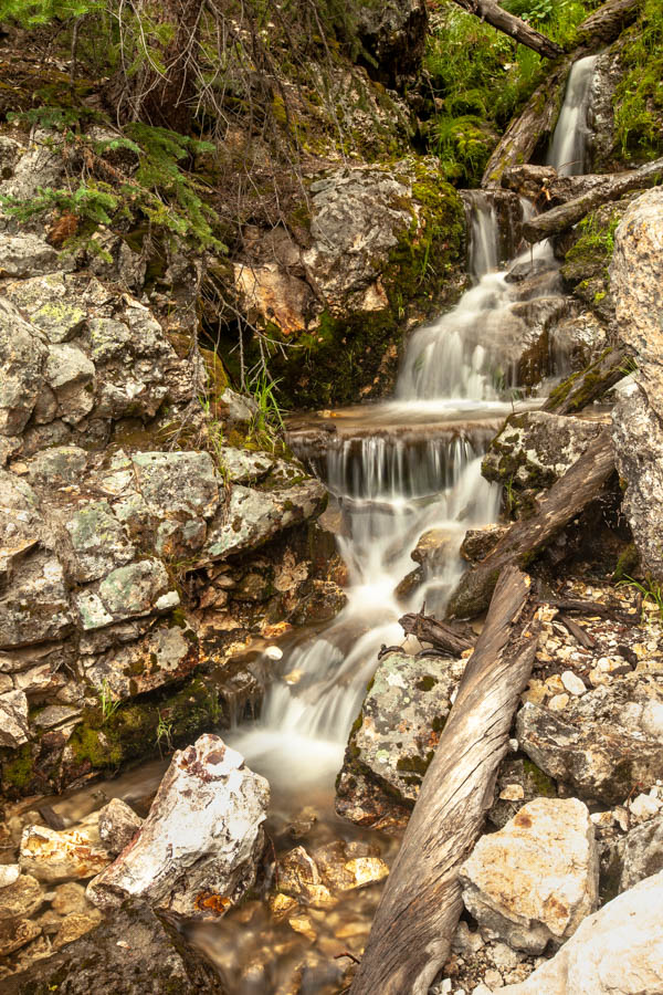 Flowing creek bed, Yellowstone National Park - How to Photograph Silky Waterfalls #vezzaniphotography