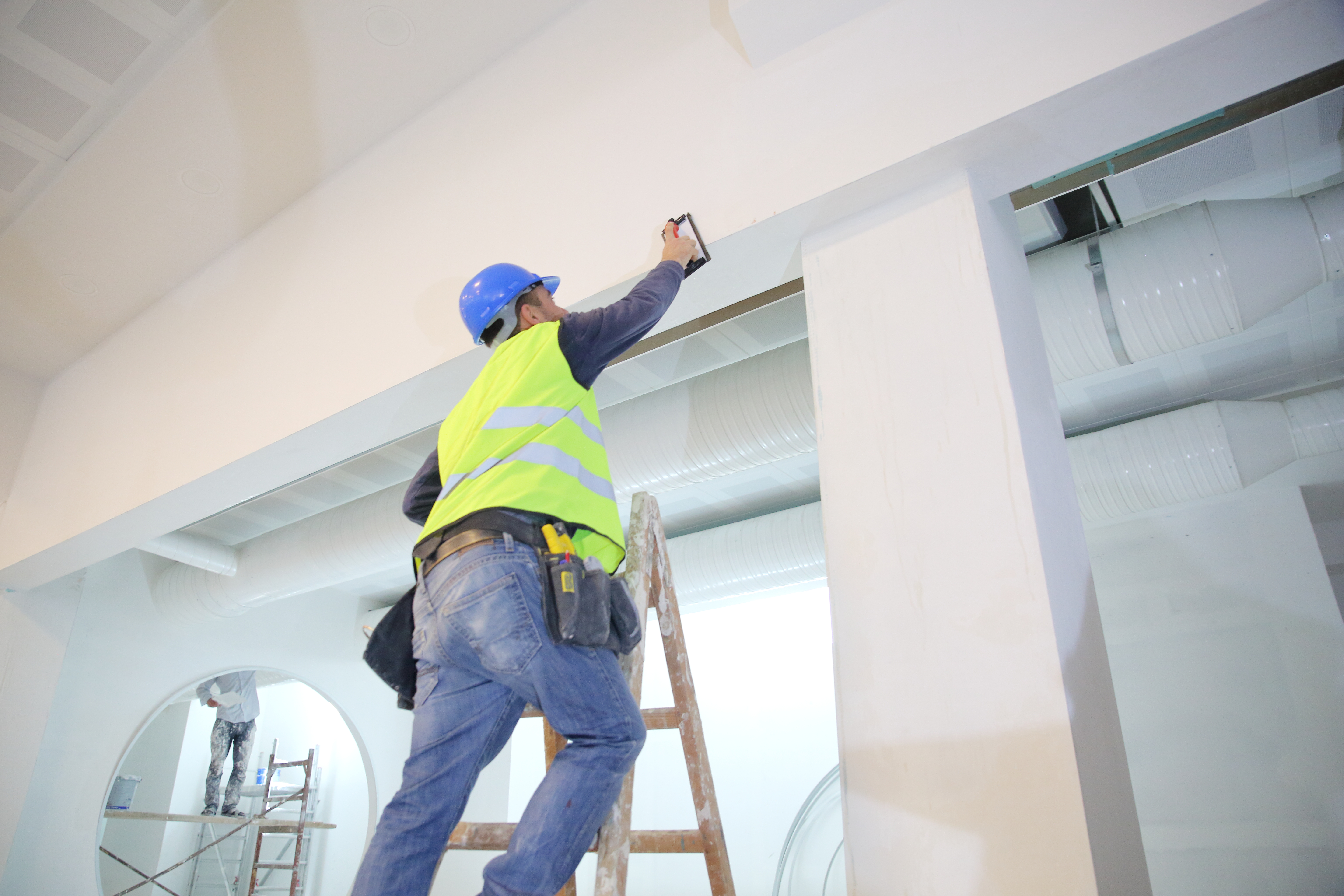 Applying Drywall Mud With A Roller