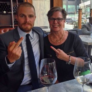 Actor Stephen Amell and his mother giving cancer the finger.