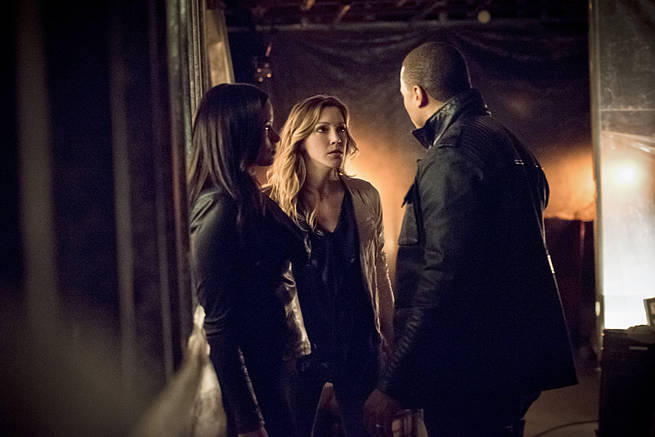 "Arrow -- ""Al Sah-Him"" -- Image AR321A_0024b-- Pictured (L-R): Katrina Law as Nyssa Al Ghul, Katie Cassidy as Laurel Lance and David Ramsey as John Diggle -- Photo: Dean Buscher/The CW -- © 2015 The CW Network, LLC. All Rights Reserved."