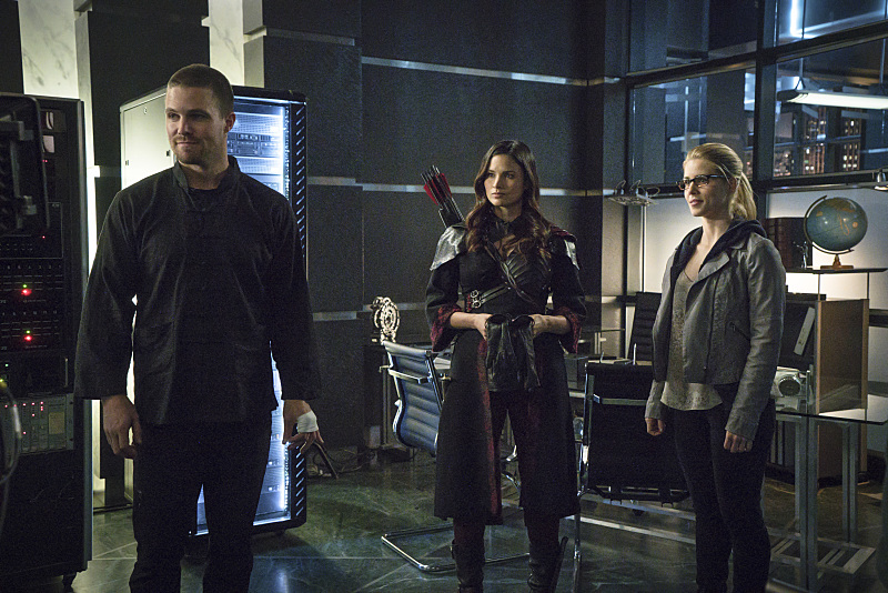 "Arrow -- ""My Name is Oliver Queen"" -- Image AR323B_0353b -- Pictured (L-R): Stephen Amell as Oliver Queen, Katrina Law as Nyssa al Ghul and Emily Bett Rickards as Felicity Smoak -- Photo: Liane Hentscher/The CW -- © 2015 The CW Network, LLC. All Rights Reserved."