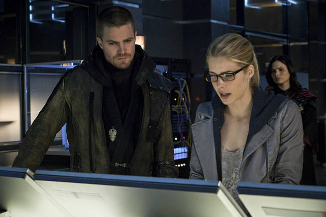 "Arrow -- ""My Name is Oliver Queen"" -- Image AR323B_0005b -- Pictured (L-R): Stephen Amell as Oliver Queen and Emily Bett Rickards as Felicity Smoak -- Photo: Liane Hentscher/The CW -- © 2015 The CW Network, LLC. All Rights Reserved."
