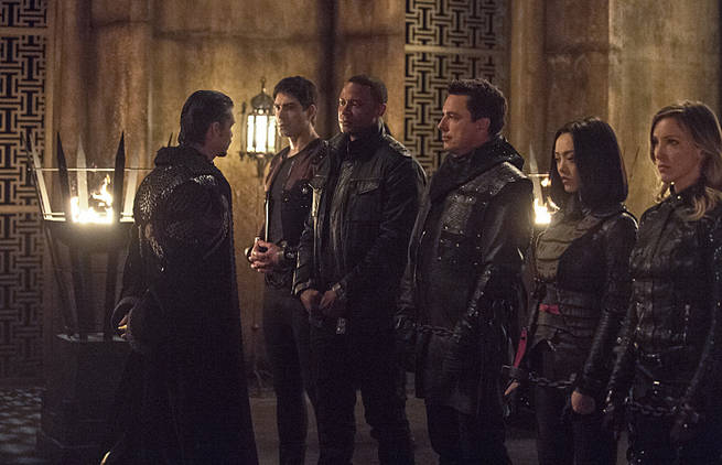 """Arrow -- """"This is Your Sword"""" -- Image AR322B_0077b -- Pictured (L-R): Brandon Routh as Ray Palmer, David Ramsey as John Diggle, John Barrowman as Malcolm Merlyn, Rila Fukushima as Tatsu Yamashiro and Katie Cassidy as Laurel Lance -- Photo: Cate Cameron/The CW -- © 2015 The CW Network, LLC. All Rights Reserved."""