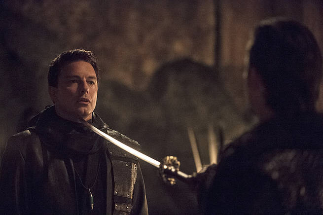"""Arrow -- """"This is Your Sword"""" -- Image AR322A_0175b -- Pictured: John Barrowman as Malcolm Merlyn -- Photo: Cate Cameron/The CW -- © 2015 The CW Network, LLC. All Rights Reserved."""