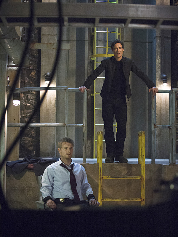 "The Flash -- ""Grodd Lives"" -- Image FLA121B_0130bc -- Pictured (L-R): Rick Cosnett as Detective Eddie Thawne and Tom Cavanagh as Harrison Wells -- Photo: Cate Cameron/The CW -- © 2015 The CW Network, LLC. All rights reserved."